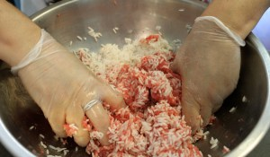Starting to mix together the rice and meat. It's best done with your hands.