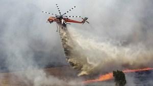 Erickson Air Crane makes a drop on a Tasmanian bushfire
