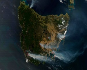 Tasmanian bushfires 2013 satellit image, taken during the peak of the bushfire emergency. Smoke plumes clearly visible for a number of the bushfires.