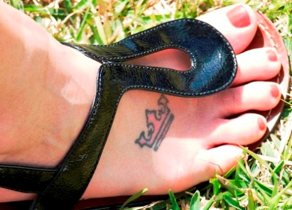 Small Crown Tattoo On Foot For Girls of 11 by Cody