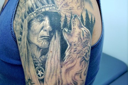native american indian tattoo on biceps