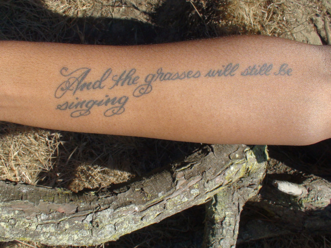 And The Grasses Will Still Be Singing Literary Tattoo On Arm of 4 by Emily