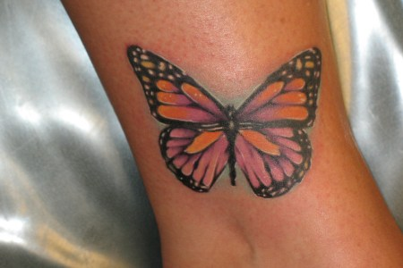 erfly tattoo on leg