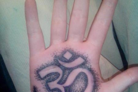 om tattoo design on palm