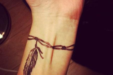 cool wrist feather celt tattoo design for men