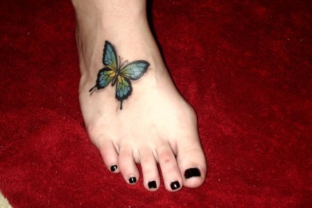 erfly tattoos on foot
