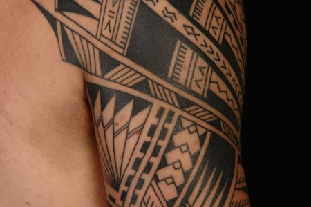 polynesian design tattoo on shoulder.jpg