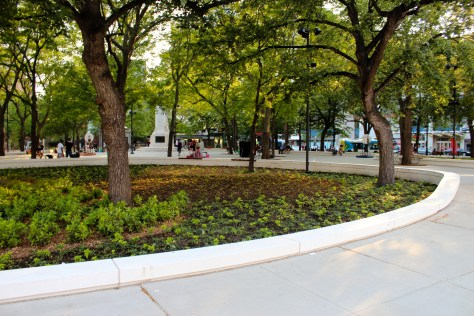 Green space in Cabot Square is now defined by oversized curbs