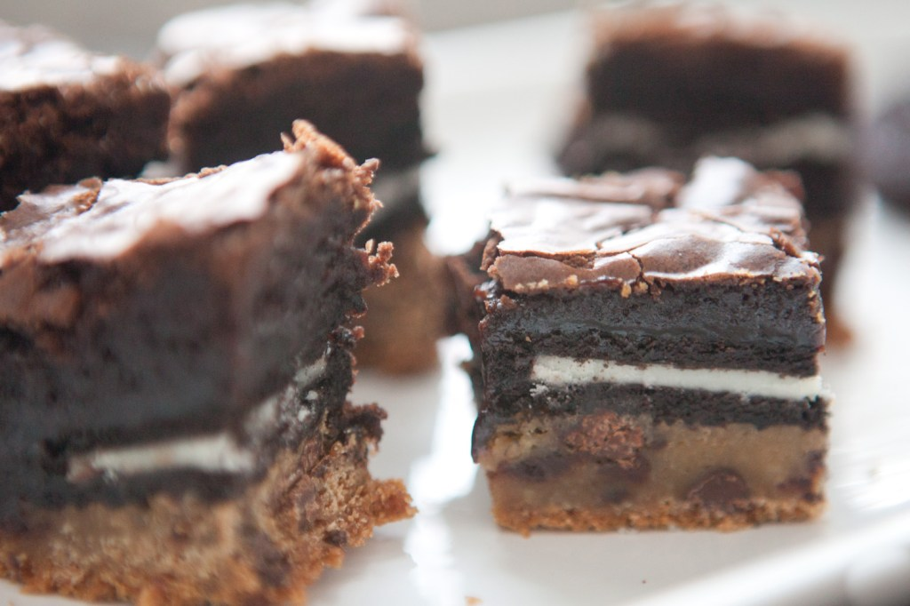 visible layers of chocolate chip cookies oreo and brownies