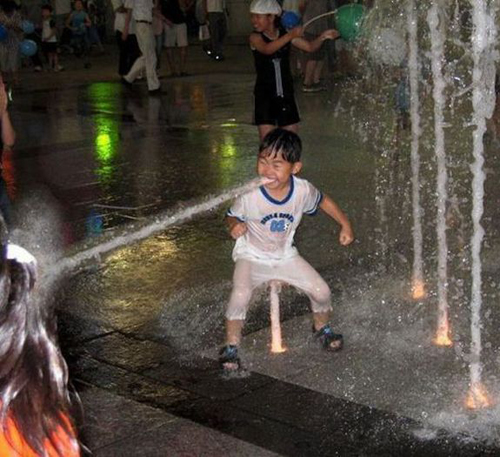 boy in water fountain Balls door knocker funny pictures weird pictures pics awkward family photos bad tattoos worst tattoos stupid people bad family photos funny family pics random strange