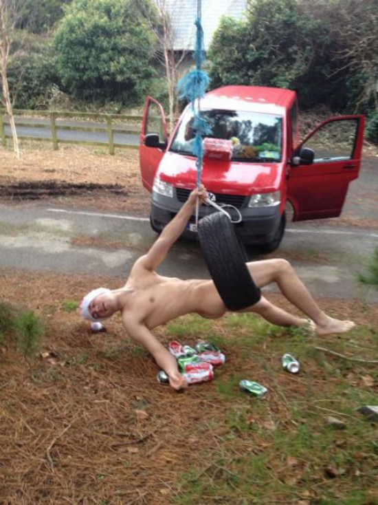 Drunk Naked Guy on Tire Swing ~ 25 Funny, Creepy Family Christmas Photos