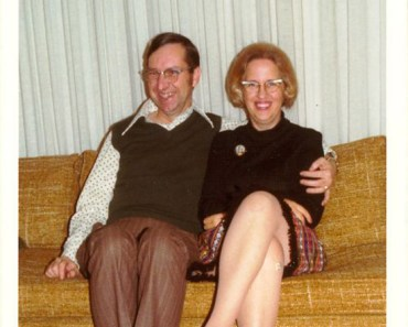 Awkward vintage 1950s snapshot of nerdy couple on couch