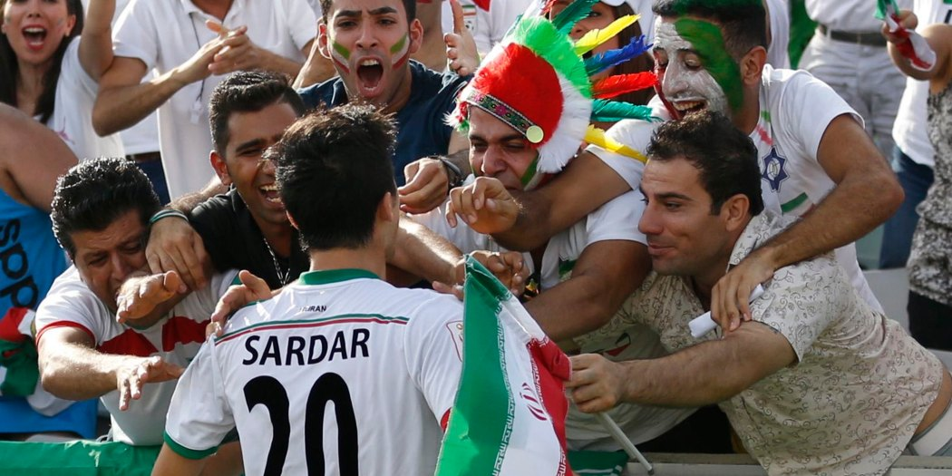 Iran's Sardar Azmoun celebrates his goal with fans during their Asian Cup quarter-final soccer match against Iraq at the Canberra stadium in Canberra January 23, 2015. REUTERS/Tim Wimborne (AUSTRALIA  - Tags: SOCCER SPORT)    Picture Supplied by Action Images