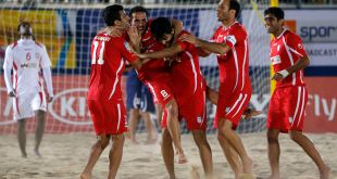 Iran players celebrate after their World Cup 2013 Beach Soccer qualifying semi-final match against UAE on Katara beach in Doha January 25, 2013. REUTERS/Fadi Al-Assaad (QATAR - Tags: SPORT SOCCER)