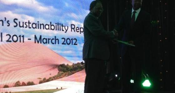 Bob Collymore handing Over the Sustainability Report to the Safaricom Chairman Nicholas Nganga