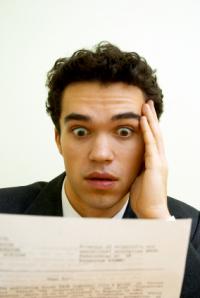surprised-man-reading-letter