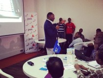 The Right Reverend Bitange Ndemo pontificates over the flock at Africa Hackcon