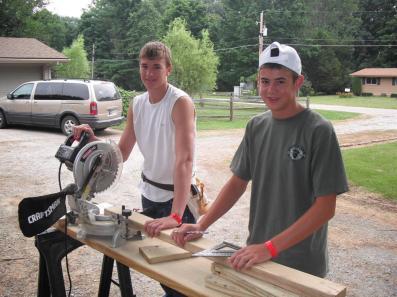 2 guys cutting board - crew 22 Butler