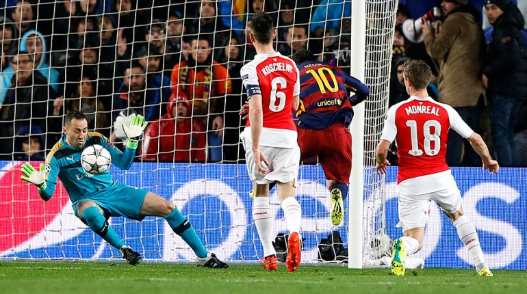 Football Soccer - FC Barcelona v Arsenal - UEFA Champions League Round of 16 Second Leg - The Nou Camp, Barcelona, Spain - 16/3/16 Barcelona's Lionel Messi has a shot saved by Arsenal's David Ospina Action Images via Reuters / Carl Recine Livepic EDITORIAL USE ONLY.