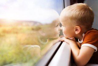 Little boy travelling in train