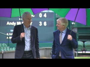 Tennis legend John McEnroe and CBS Newsman Mark Phillips in Wimbledon's Centre Court for a 60 MINUTES SPORTS story on the famous club and tournament to premiere on the next edition of 60 MINUTES SPORTS  Wednesday, June 4 at 9:00 p.m. ET/PT on SHOWTIME (Photo courtesy: SHOWTIME).