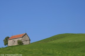 A solitary hut in lucid green and blue