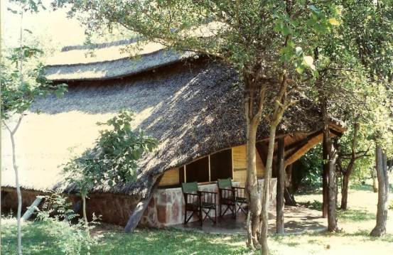 Thatched roofed lodges Fothergill Island, at Lake Kariba