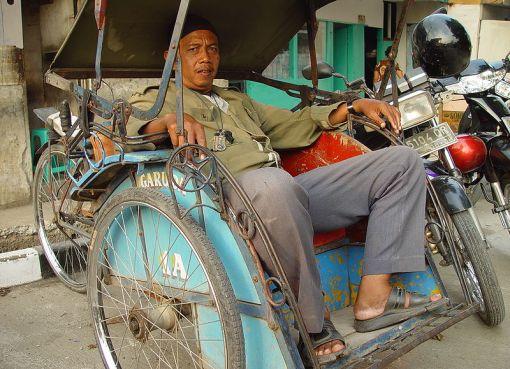 Becak and driver in Ciputat, Indonesia