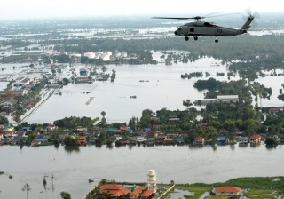 Helicopter flies over flood hit Bangkok