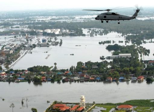 Helicopter flies over flood hit Bangkok