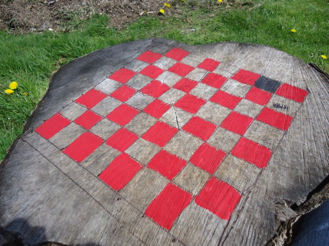 checkers game board on stump