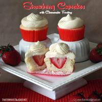 Surprise Strawberry Cupcakes with Cheesecake Frosting