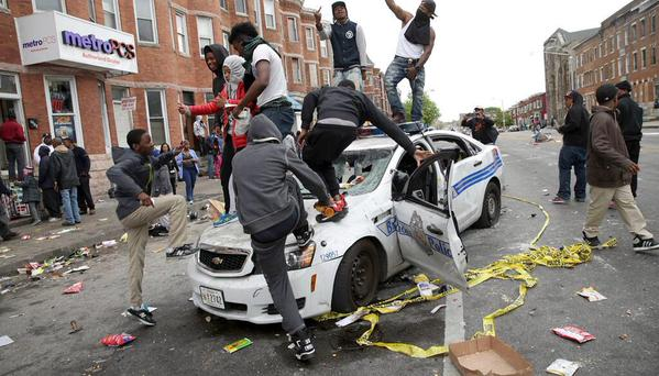 Thugs take a spring break on police car in Baltimore riots in 2015.