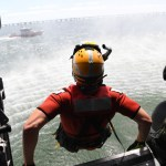 Photo by Petty Officer 3rd Class Joshua Canup  U.S. Coast Guard District 5    Subscribe 13  A rescue swimmer with Coast Guard Air Station Elizabeth City, North Carolina jumps from a helicopter during training Sunday, June 13, 2016. Part of Air Station Elizabeth City's mission is to minimize injury and loss of life, property damage and render aid to persons in distress as expeditious and safe as humanly possible.