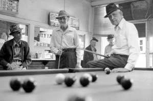 Roscoe P. Ricks, 86, and T.M. Fitzpatrick. 94, play a game of pool at the Dixie Poolhall and Cafe while Charlie Duncan, 70, looks on -- March 1977.