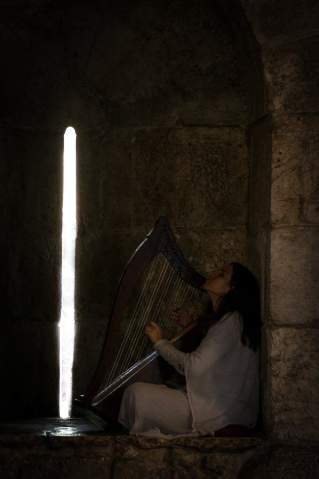 A girl playing the harp in Jerusalem, Israel