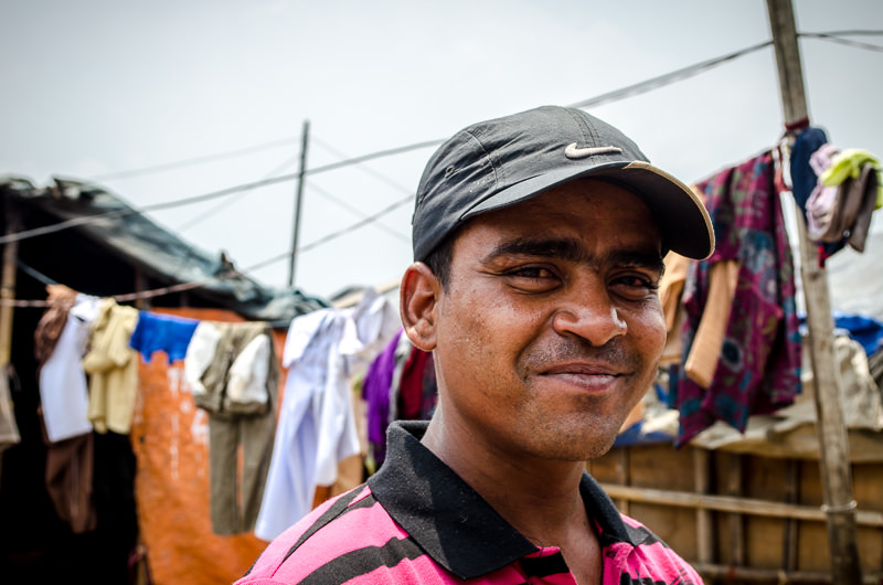 Raj, king of the scam, outside of his home in tent city, Kathmandu, Nepal.
