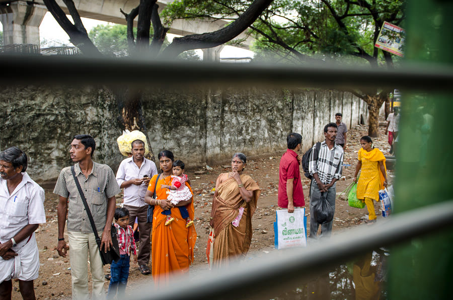 People standing along the street in Chennai, India