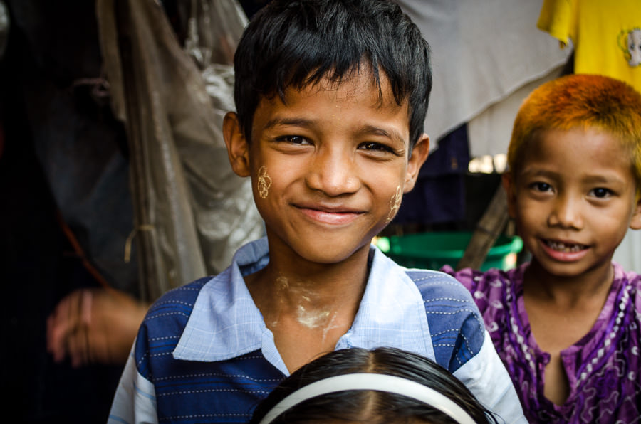 Young boy in the alleyway near his home in Myanmar