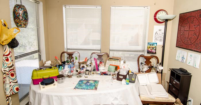 Our dining table covered in art supplies