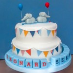 Elephants with balloons, colourful bunting and name blocks