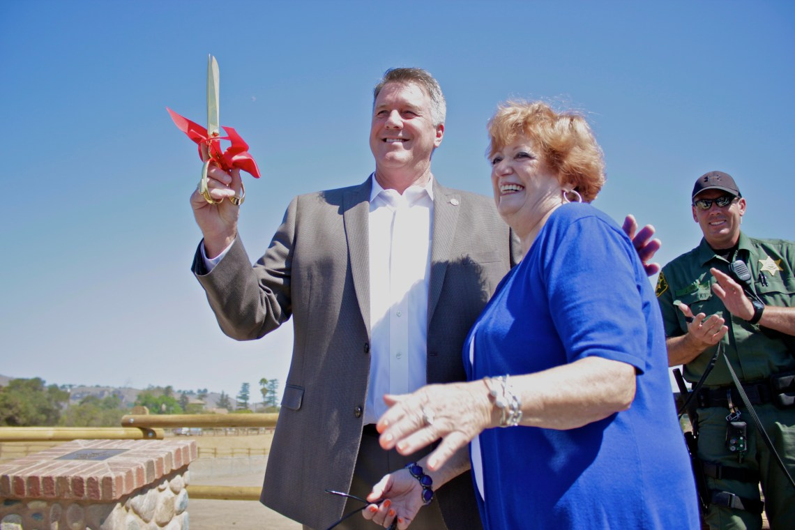 Mayor John Taylor and Goldee Cortese celebrate after cutting the ribbon. Photo by Brian Park
