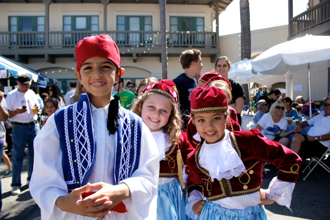 Members of St. Basil's youth dance team prepare to take the floor during the Greek Festival. Photo by Brian Park