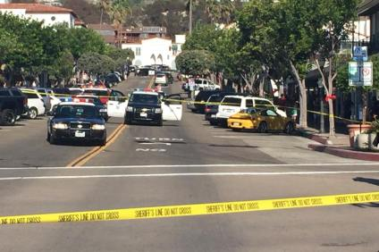Orange County Sheriff's Department deputies block off Avenida Del Mar in San Clemente following a shooting Saturday afternoon at a local boutique that left two people dead. Photo: Jim Shilander