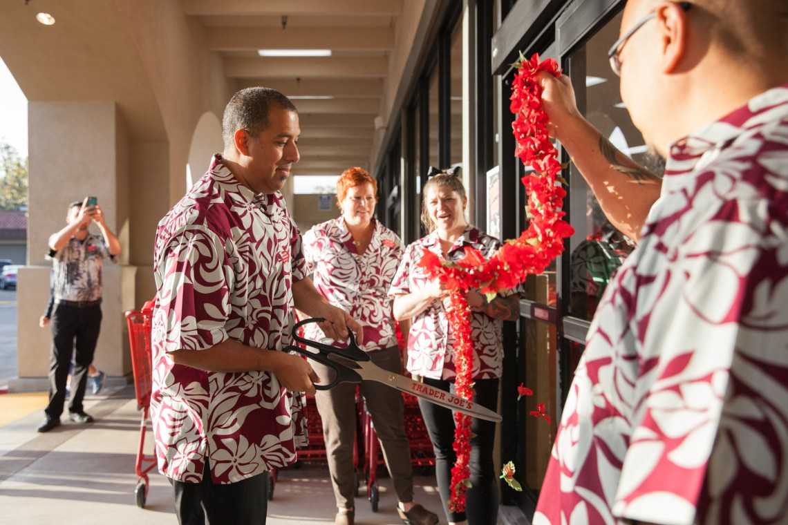 Store Captain Mike Rosales cuts the lei during the Oct. 11 grand opening. Photo: Allison Jarrell