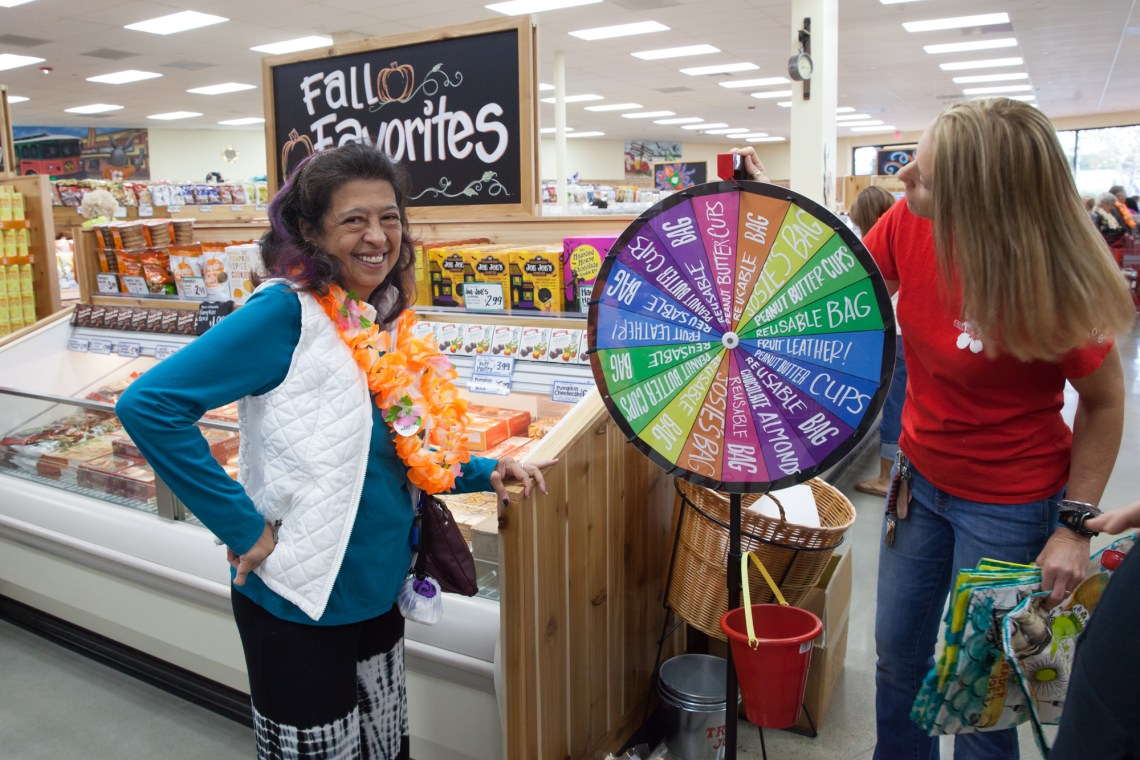 Virgy McBride, of San Juan Capistrano, tests her luck during the Trader Joe's grand opening. Photo: Allison Jarrell
