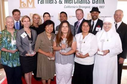 "Cynthia Roe, (front row, far left) of San Juan Capistrano, was one of 10 people honored by Farmers & Merchants Bank on Nov. 3 at the seventh annual ""California's Strongest People You Can Bank On"" awards. Photo: Courtesy of Farmers & Merchants Bank"