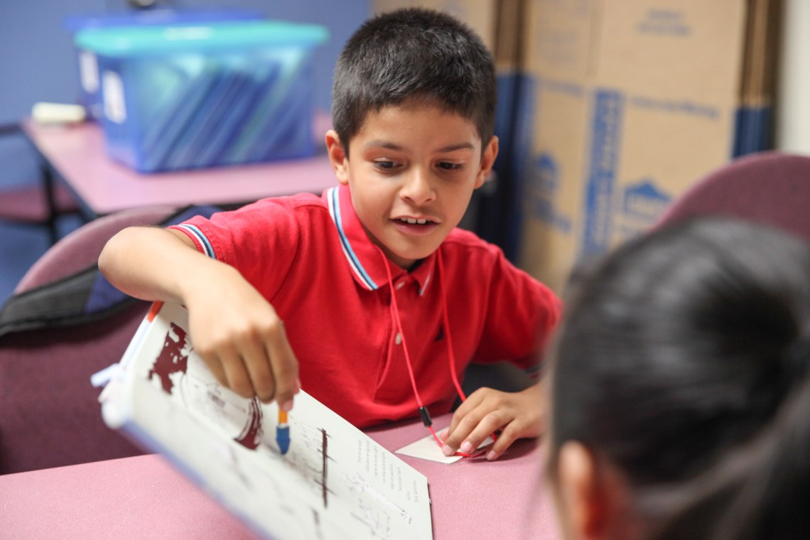 Diego Prado participates in a reading exercise during a tutoring session at the Boys & Girls Clubs of Capistrano Valley. Photo: Allison Jarrell