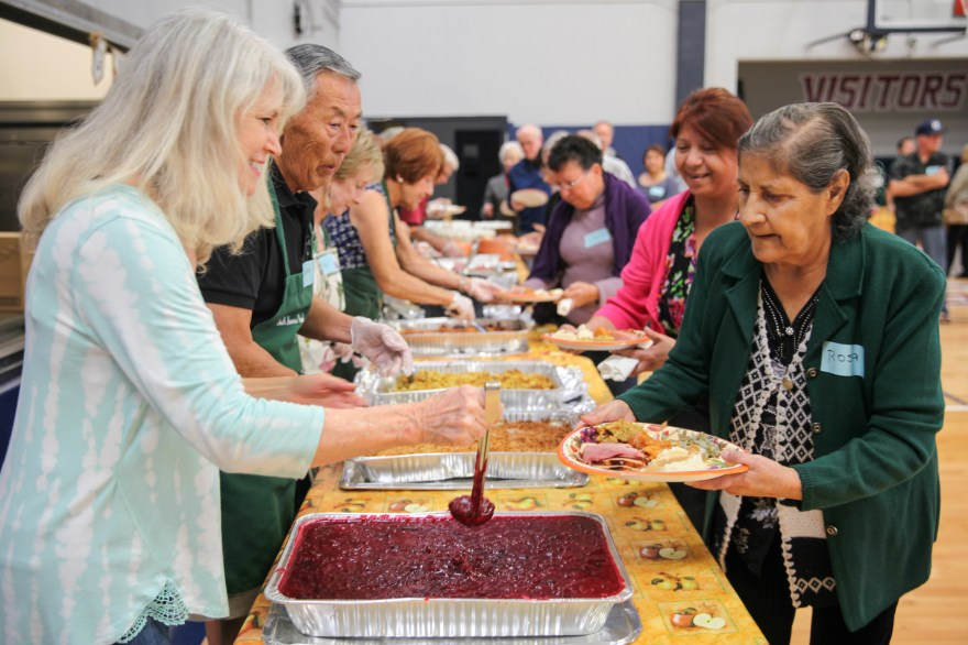Church volunteers serve local families during the fourth annual Love Thy Neighbor Thanksgiving dinner at South Shores Church on Nov. 19. Photo: Allison Jarrell