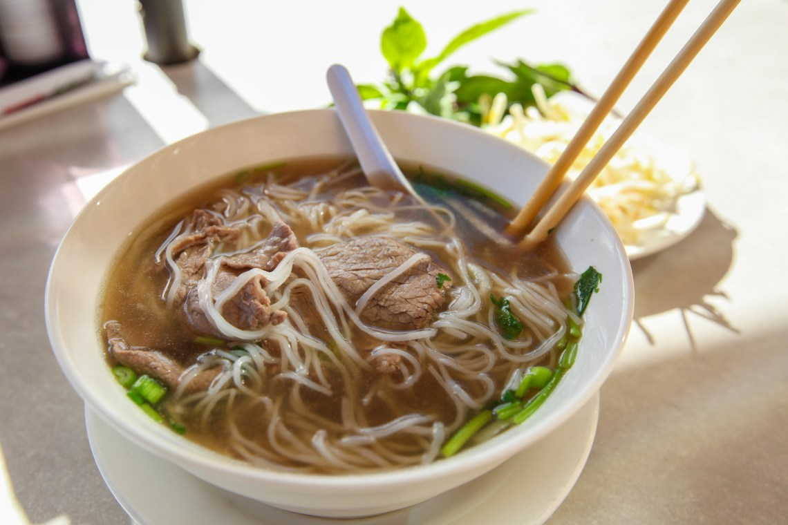Traditional pho at Pho Thanh Binh is served with beef or chicken, rice noodles, some onion and cilantro, and beef broth. The restaurant also serves generously-sized bowls of pho with toppings like bean sprouts, basil, lime and jalapeños.